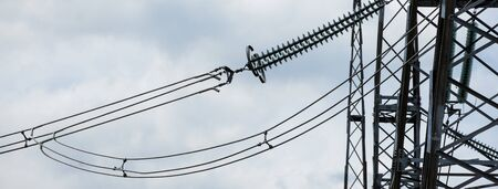 Electric power transmission lines. High voltage switchgear and equipment in front of power plant. Stockfoto