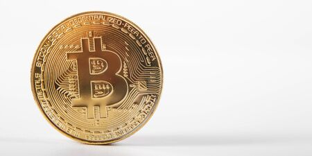 Golden bitcoin on isolated on white table. A visual representation of digital cryptocurrencies. Bitcoin are fully dematerialized and decentralized electronic currencies