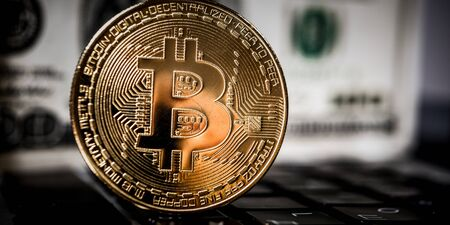 New virtual money Golden bitcoin coin on a black keyboard. Cryptocurrency. Business and Trading concept. Stock Photo
