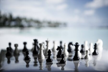 Chess strategy concept is on the background of the beach. Abstract background of business concept . Selective focus shallow depth field.