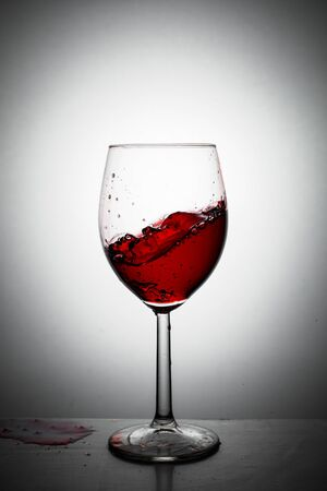 Red wine up and splash from a glass