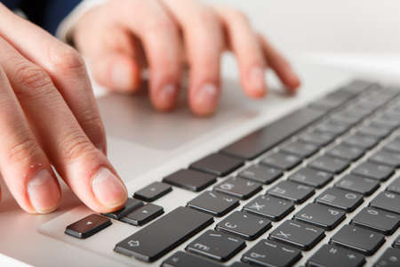 Laptop with man hand isolated on white background