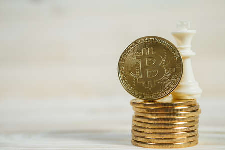 Conceptual cryptocurrency bitcoin with the word Finance on white background