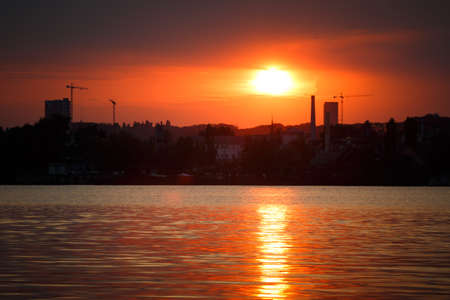Silhouette panorama at sunset colorful sky over Dnipro river in Kyiv