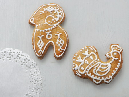 Homemade Christmas sugar cookies glazed with royal icing. Christmas biscuits in the shape of turkey and sheep. Selective focus. Stock Photo