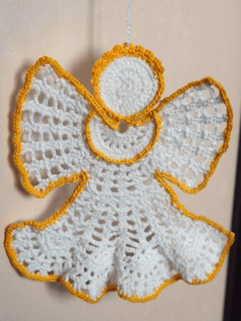 Christmas tree decoration. Crochet angel. Handmade ornament. Selective focus. Archivio Fotografico