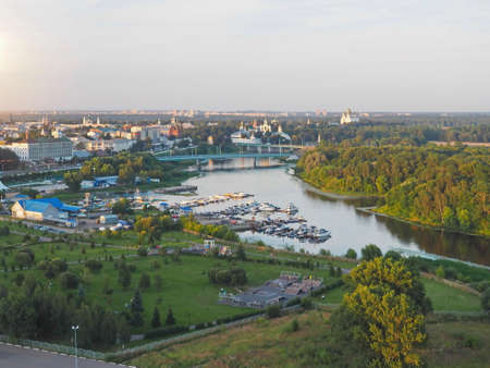 Aerial view of provincial town on the Kotorosl river. Bright sunset under small river. Yaroslavl, Russia.