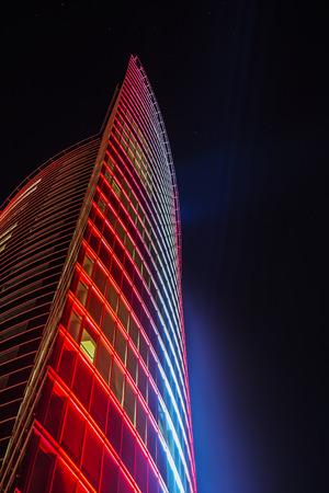 aspirant: fragment of illuminated buildings, the aspirant into the night sky