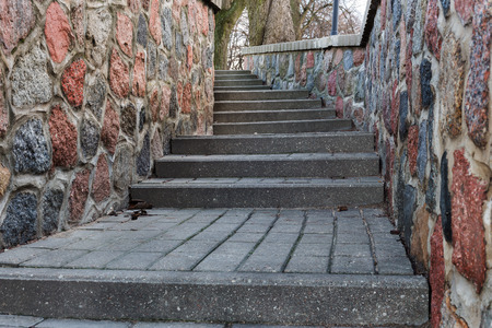 tortuous: tortuous ascent of stone steps between the stone walls in autumn day