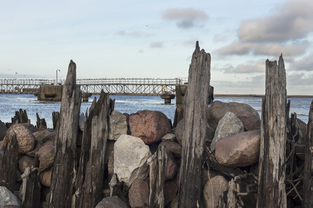 breakwaters: Breakwaters on the Baltic Sea in stone and wood Stock Photo