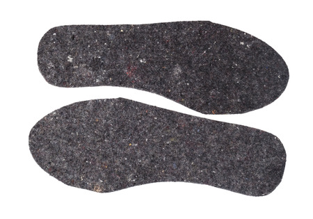insoles: Felt insoles for shoes isolated on white background,roughly trimmed