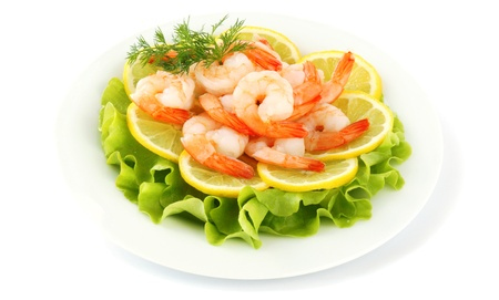 dinne: Boiled shrimps with lemon and lettuce leaves on plate, isolated on white