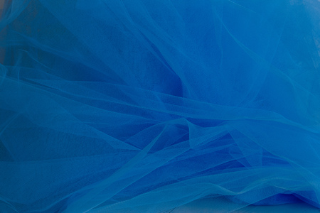 Texture of crumpled blue tulle fabric