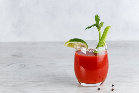 Bloody Mary Cocktail with Celery and Lime Banco de Imagens - 121889028