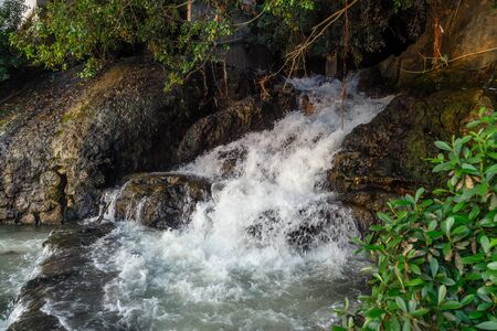 Streams of water from a rocky hill, mountain stream Imagens