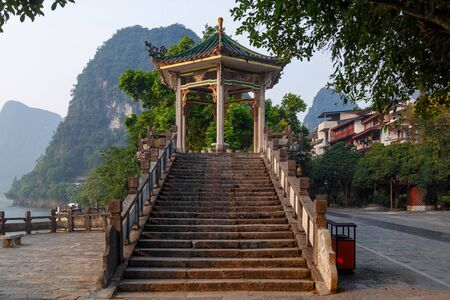 Stone staircase to the pagoda in the tourist city of Yangshuo, China Stock Photo