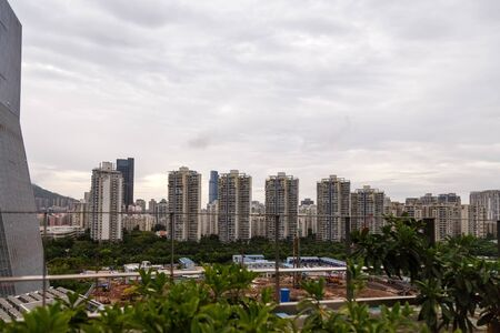View of the construction of municipal residential buildings in a metropolis from a rooftop cafe, Shenzhen, China, Asia Imagens