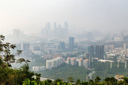 View of the foggy city from the mountains in the early morning, Shenzhen, China, Asia