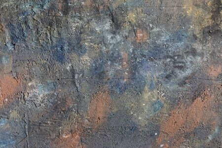 Surface of a multi-colored textured wall, background