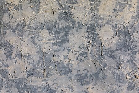 Surface of a gray textured wall, background