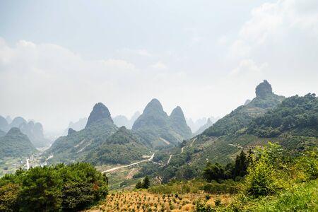 View of the picturesque mountainous terrain, Scenic Mountain View, Yangshuo, China, Asia