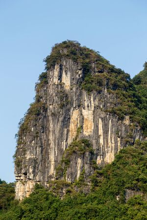 Rock mountain in the shape of a cliff on a sunny day Imagens