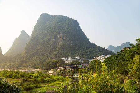 Mountains and Valley in Yangshuo Province, China, early foggy morning