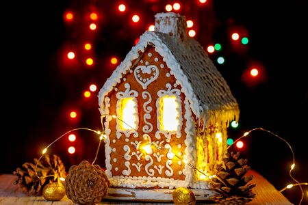 Gingerbread house with bokeh of light bulbs in the background
