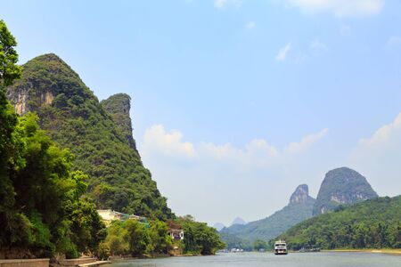 Great view of the mountains and the river on a clear sunny day, Yangshuo, China, Asia Imagens