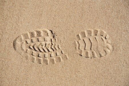 Footprint on wet sand on the seashore