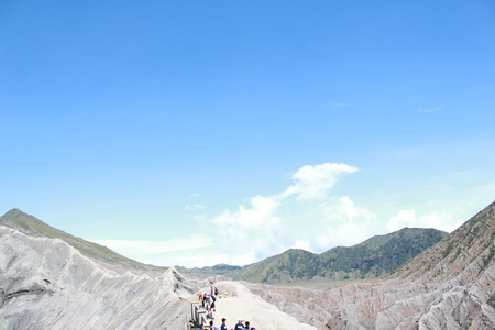 Tourists at the crater of Mount Bromo at sunrise in Bromo Tengger Semeru National Park Stock Photo
