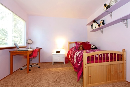bed room: Girls bedroom with pink bedding and puple walls