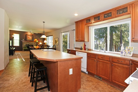 Kitchen with oak cabinets and a view of living room Stock Photo - 12320997
