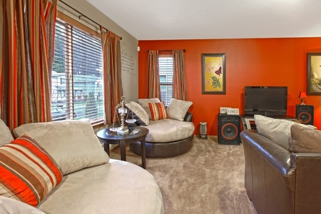 interior spaces: Red wall and asian style with comfortable modern furniture