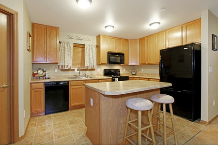 Light color kitchen with black appliances Stock Photo - 12313579