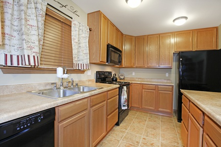 Light wood kitchen woth black appliances Stock Photo - 12313692