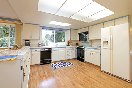 White and blue kitchen with nice hardwood floor photo