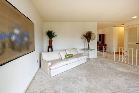 modern sofa: Almost empty living room of older home from sixties Stock Photo