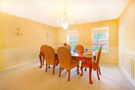 Very beautiful dining room with antique table and chairs photo
