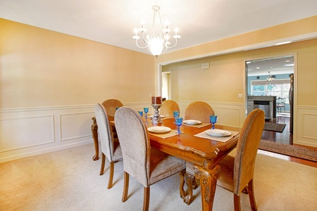 Dining room with antique table and yellow walls photo