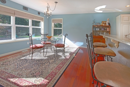 Breakfast area with sunlight and blue walls photo
