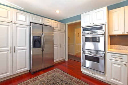 stove: White kitchen with cherry hardwood
