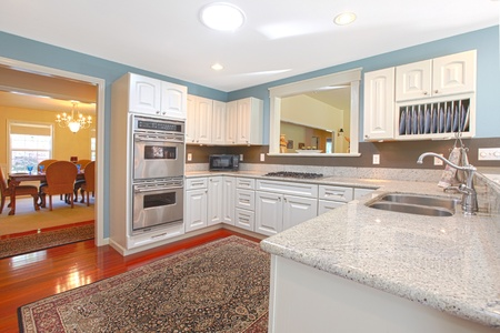 White kitchen with cheryy hardwood photo