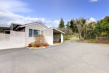 Old small house with a very large drive way Stock Photo - 12312907
