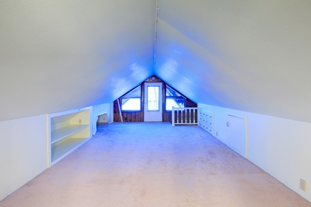 Small room with vaulted ceiling and blue light Stock Photo - 12312885