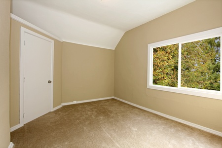 New beige bedroom with large window Stock Photo - 12312277