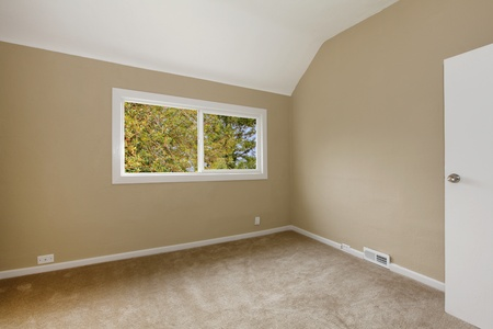 Nice empty new beige bedroom Stock Photo - 12312594