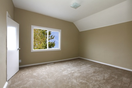 unfurnished: New beige bedroom with carpet