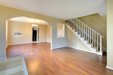 unfurnished: Living room with staircase empty and new Stock Photo