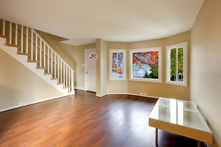 Living room with staircase and nice cherry floor photo